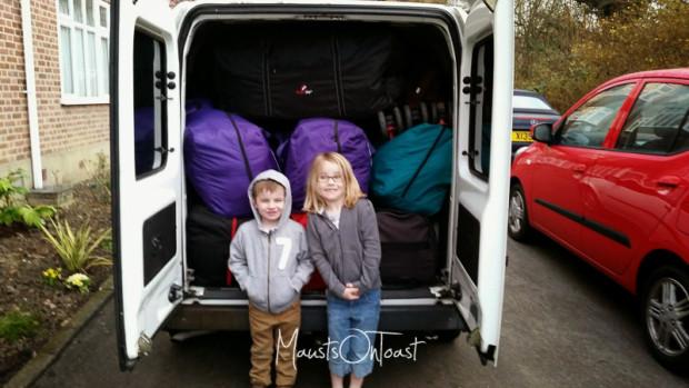Posing behind Uncle's van full of our luggage.